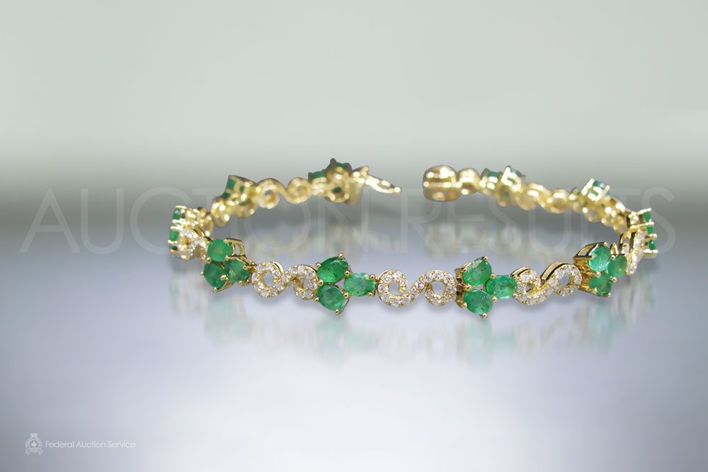 14k Yellow Gold Emerald and Diamond Bracelet sold for $3,000