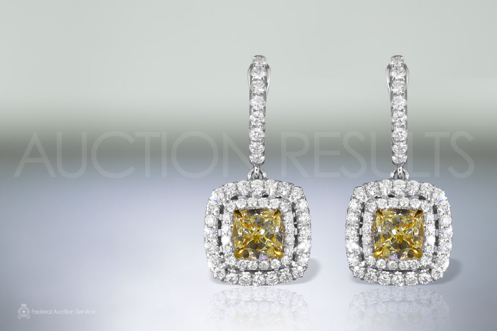 EGL Certified 2ct (TDW) Fancy Yellow Diamond Earrings sold for $14,000