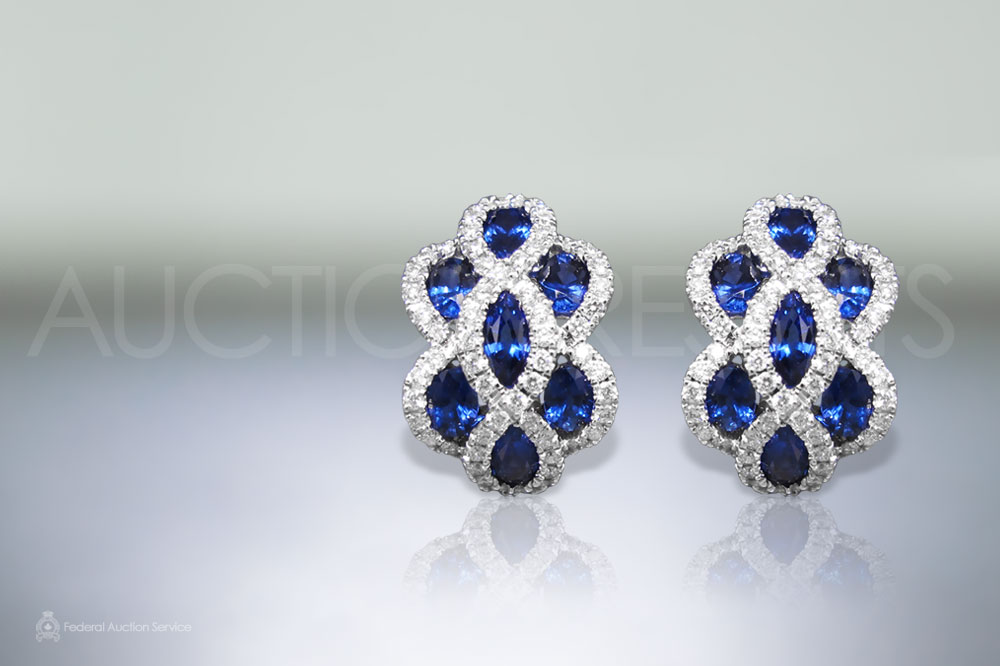 Lady's 18k White Gold Blue Sapphire and Diamond Earrings sold for $4,500