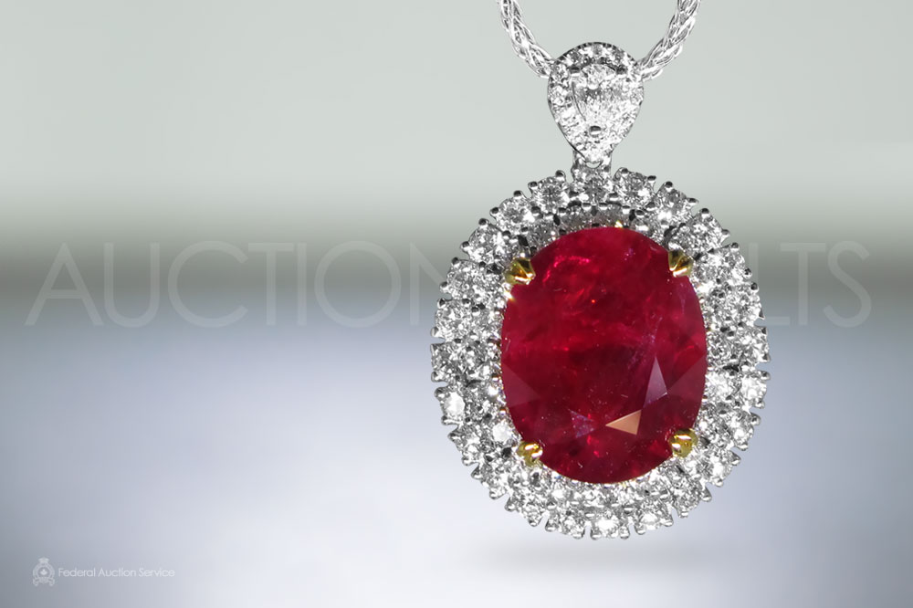 C. Dunaigre Switzerland Certified 11.58ct Oval Cut Ruby and Diamond Pendant Necklace sold for $36,000