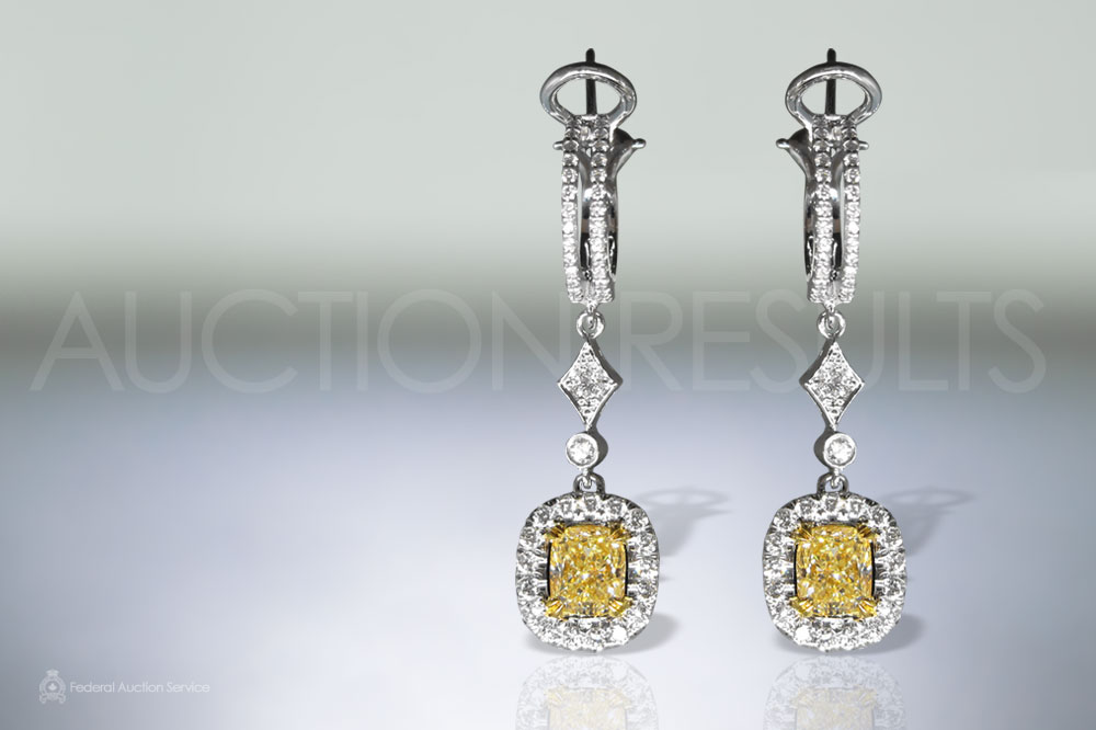 2.17ct (TDW) Fancy Yellow Diamond Earrings sold for $18,000