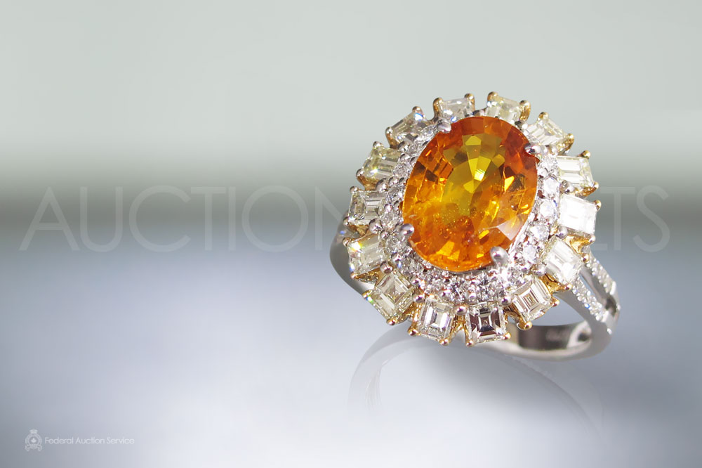 Lady's 3.16ct Orange Sapphire and Diamond Ring sold for $6,000