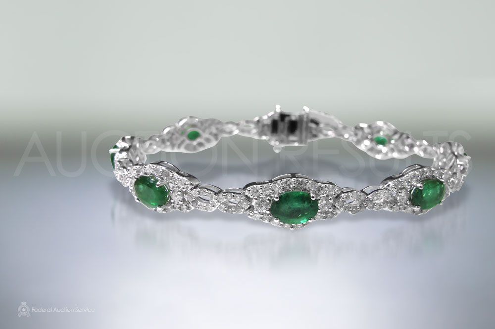 5.82ct (TW) Oval Cut Emeralds and Diamond Bracelet sold for $7,500