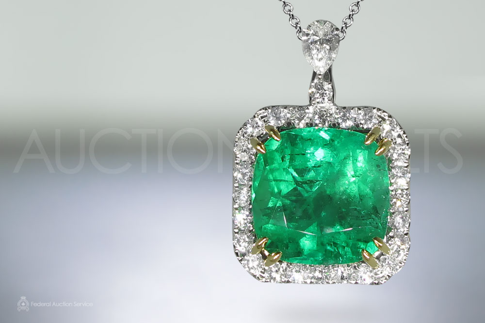 GRS Certified 14.36ct Cushion Cut Colombian Emerald and Diamond Pendant sold for $41,000