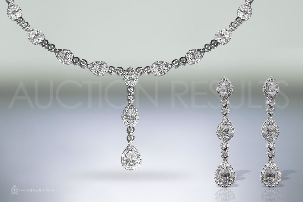 Elegant 18k White Gold 10.36ct (TDW) Diamond Necklace and Matching Earrings Set sold for $17,500