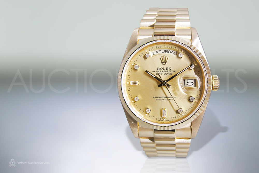 Men's 18k Yellow Gold Rolex Day-Date Automatic Wristwatch sold for $15,000