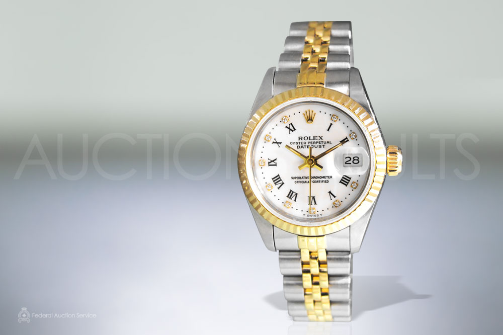 Lady's Stainless Steel/18k Yellow Gold Rolex Datejust Automatic Wristwatch sold for $6,000
