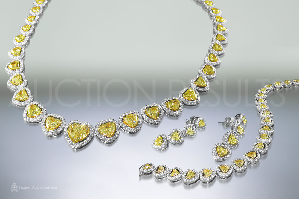 Fancy Intense Yellow Heart Shape Diamond Suite sold for $215,000