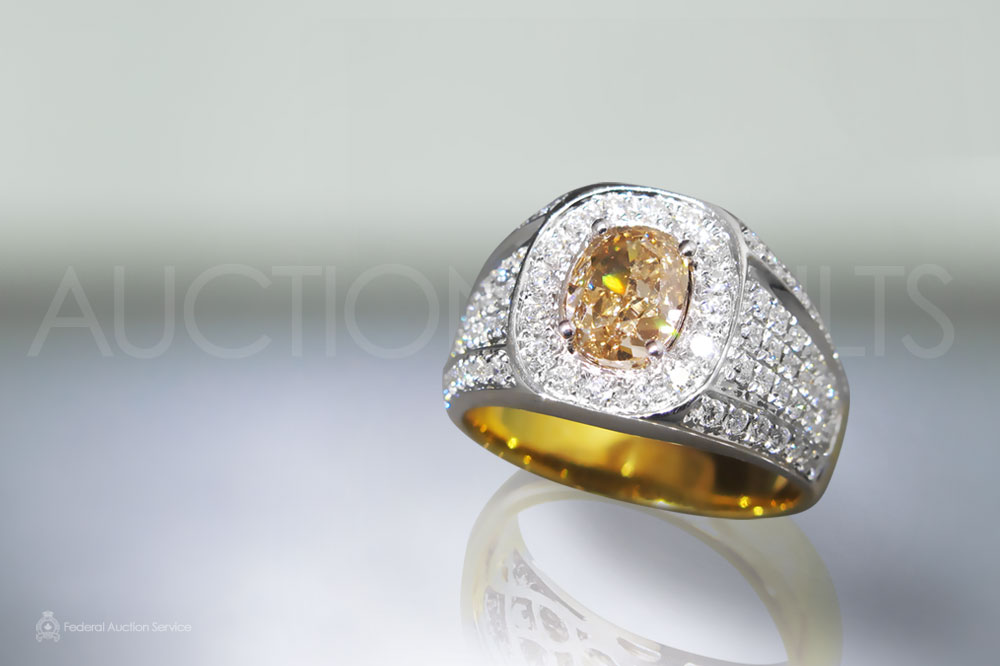 1.63ct Fancy Orange Diamond Ring sold for $8,500