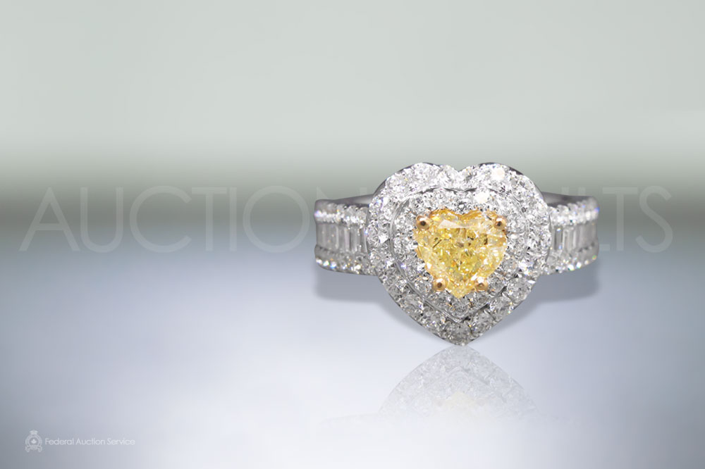 GIA Certified 0.58ct Fancy Light Yellow Diamond Ring sold for $6,100