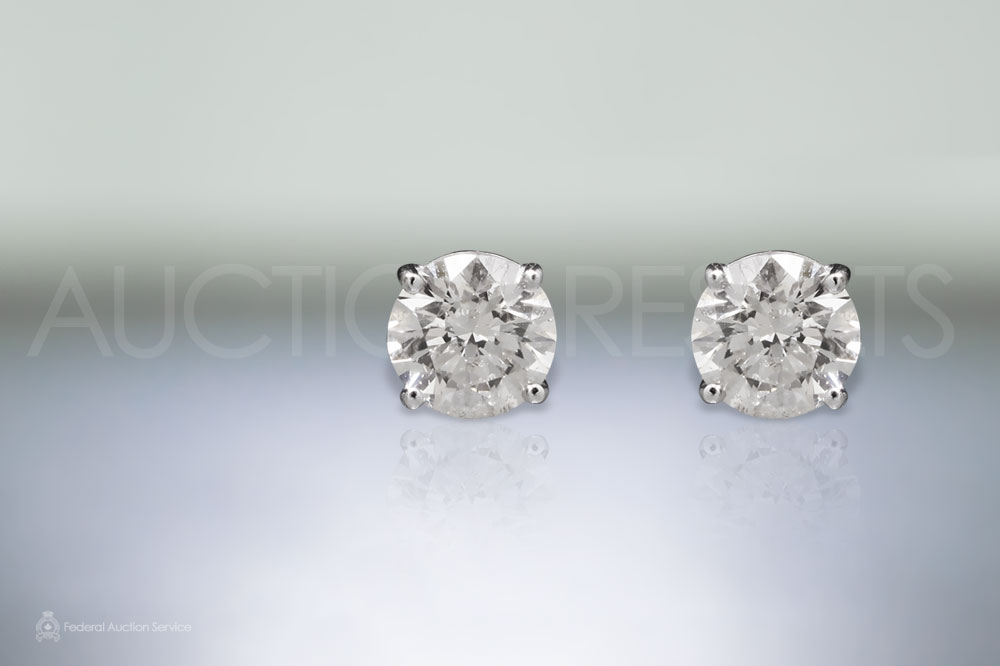 Lady's 14k White Gold 2.73ct (TDW) Canadian Diamond Stud Earrings sold for $14,000
