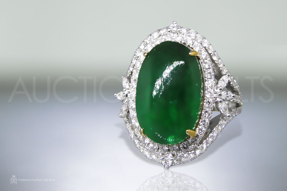 12.55ct Oval Cabochon Colombian Emerald and Diamond Ring sold for $8,000