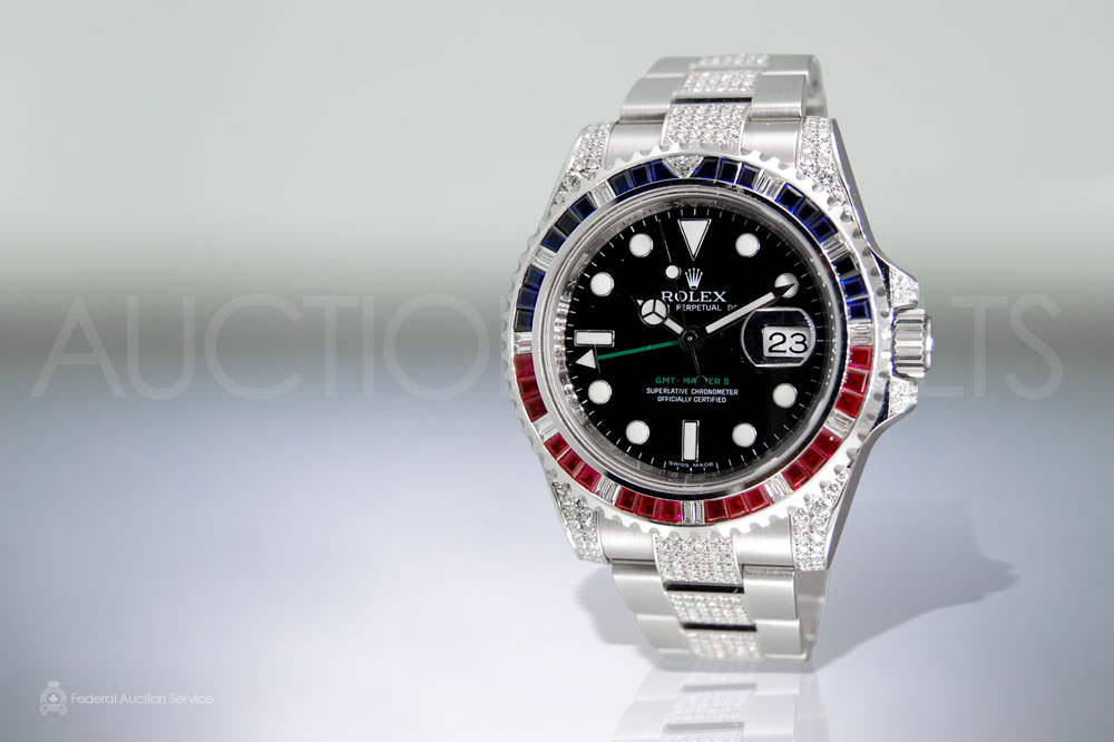 S.S. Rolex GMT-Master with Rubies and Sapphires sold for $18,000