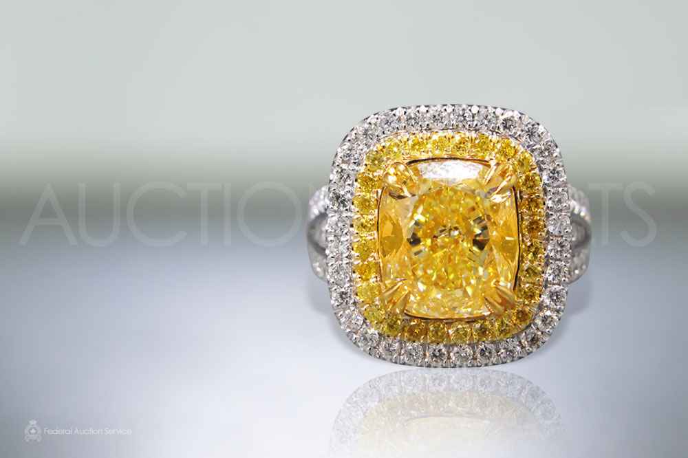 GIA Certified 5.07ct Fancy Yellow Diamond Ring sold for $101,000