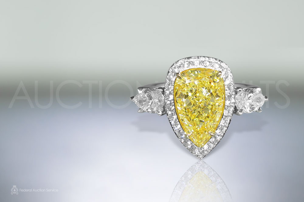 3.13ct Modified Pear Brilliant Cut Fancy Yellow Diamond Ring sold for $25,000