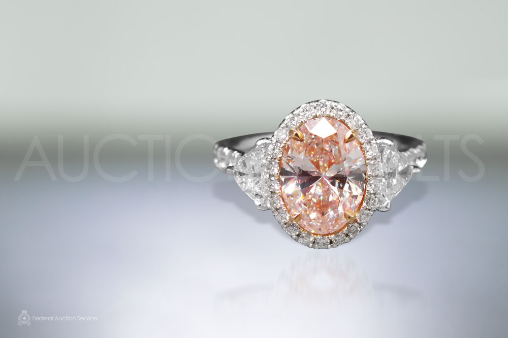 Lady's Platinum and Rose Gold 2.05ct Oval Cut Fancy Light Pink Diamond Ring sold for $51,000