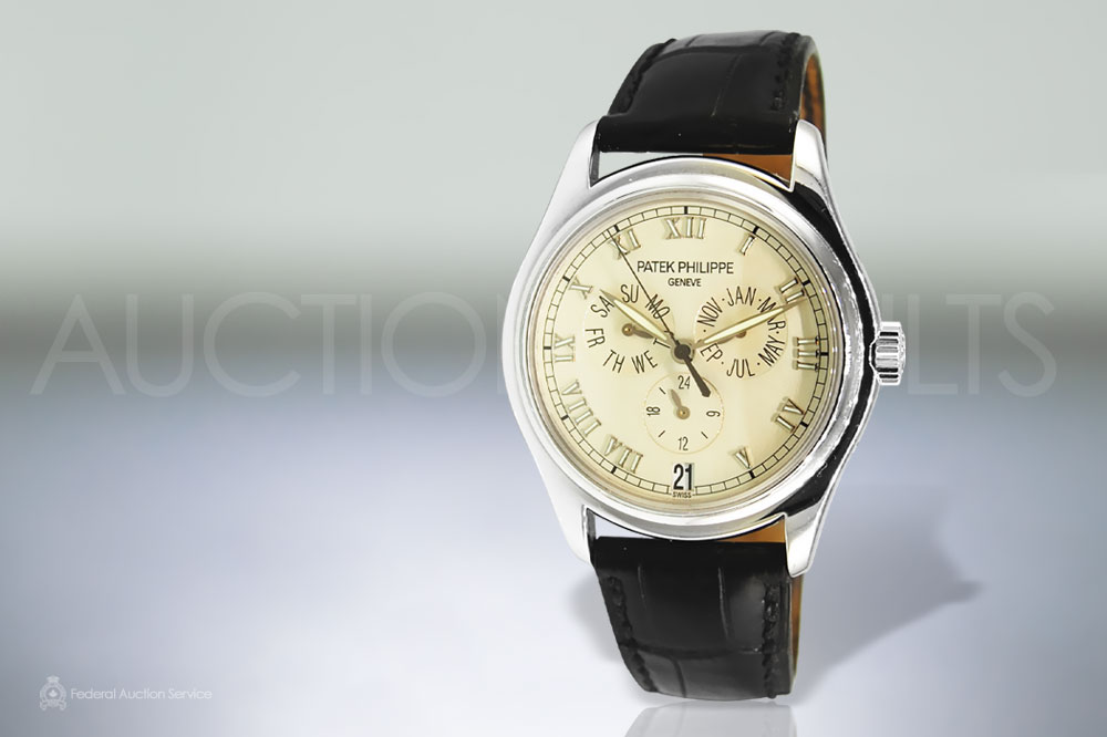 Men's 18k White Gold Patek Philippe Geneve 'Annual Calender' Self-Winding Wristwatch sold for $19,000