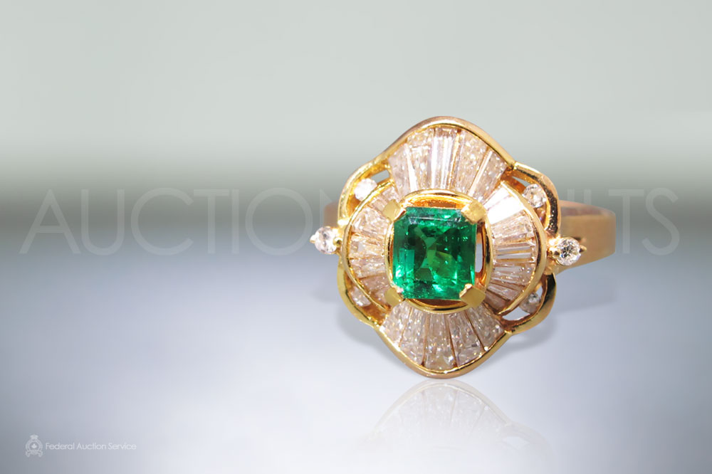 Lady's 18k Yellow Gold Emerald and Diamond Ring sold for $2,500