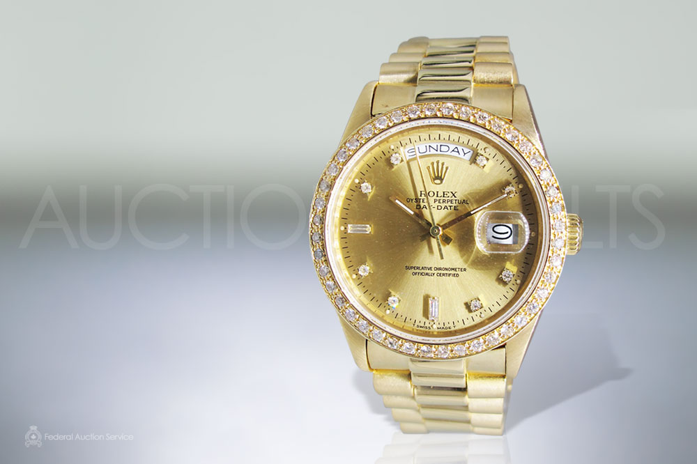 Men's 18k Yellow Gold Rolex Day-Date Automatic Wristwatch sold for $16,000